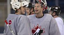 Team Canada goalkeepers Ben Scrivens and James Reimer chat during team practice Thursday (The Canadian Press/Jacques Boissinot)