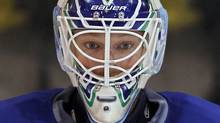 Vancouver Canucks goalie Cory Schneider (35) stands in net during hockey practice for the NHL Stanley Cup in Vancouver, British Columbia June 2, 2011. REUTERS/Mike Blake (Mike Blake/Reuters)