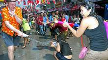 Throughout Songkran, locals delighted in deflating my hair with water.