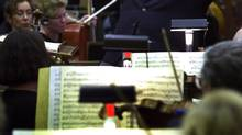 Conductor Mario Bernardi during a rehearsal in Vancouver October 19, 2001 of the CBC Vancouver Orchestra, which remains the only surviving Canadian radio orchestra. (JOHN LEHMANN/THE GLOBE AND MAIL)
