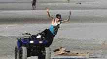 Canadian singer Justin Bieber jumps from a quad bike at a resort in Punta Chame, on the outskirts of Panama City January 27, 2014. (CARLOS JASSO/REUTERS)