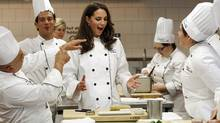 Catherine, Duchess of Cambridge, reacts during a cooking workshop at the Institut de tourisme et d'hotellerie du Quebec in Montreal July 2, 2011. (MATHIEU BELANGER/REUTERS / Mathieu Belanger)