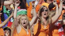 Netherlands' fans celebrate after their win over Denmark in their 2010 World Cup Group E soccer match at Soccer City stadium in Johannesburg June 14, 2010. (MICHAEL KOOREN)