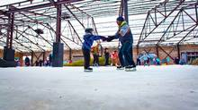 Jason Rokosh and Sophie Rokosh, four, try out Toronto's Evergreen Brick Works skating path. Malls and other commercial spaces are using skating rinks to get Canadians off the couch. (JENNIFER ROBERTS/Jennifer Roberts for The Globe and Mail)