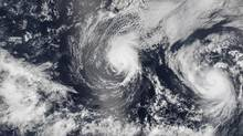 Hurricane Iselle and Hurricane Julio (R) are pictured en route to Hawaii in this August 5, 2014 NASA handout satellite image. Hurricane Iselle is expected to make landfall on Hawaii August 7, 2014. REUTERS/NASA/Handout via Reuters (UNITED STATES - Tags: ENVIRONMENT) THIS IMAGE HAS BEEN SUPPLIED BY A THIRD PARTY. IT IS DISTRIBUTED, EXACTLY AS RECEIVED BY REUTERS, AS A SERVICE TO CLIENTS. FOR EDITORIAL USE ONLY. NOT FOR SALE FOR MARKETING OR ADVERTISING CAMPAIGNS (NASA/REUTERS)
