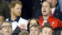 Britain's Prince William, right, sings the national anthem of Wales as Prince Harry looks on ahead of a Rugby World Cup match on Sept. 26, 2015. (Kirsty Wigglesworth/AP)