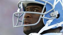 FILE - In this photo taken on Nov. 15, 2009, Tennessee Titans quarterback Vince Young looks on during the third quarter of an NFL football game against the Buffalo Bills in Nashville, Tenn. (Wade Payne/AP2009)