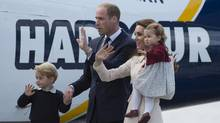The Duke and Duchess of Cambridge along with their children Prince George and Princess Charlotte get on a float plane as they prepare to depart Victoria, B.C. Saturday, Oct. 1, 2016. (JONATHAN HAYWARD/THE CANADIAN PRESS)
