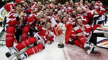 The players of Team Canada celebrate with the winner's trophy after winning the 86th Spengler Cup ice hockey tournament (Salvatore Di Nolfi/AP)
