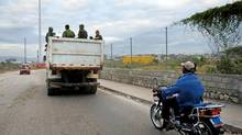 In this image released by the UN January 25, 2010 shows a truck with Colombian soldiers drives in downtown Port au Prince. (MARCO DORMINO/AFP/Getty Images)