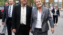 Parti Quebecois leader Pauline Marois (R) smiles as she walks with her husband Claude Blanchet following her vote in her home riding in Beaupre, Quebec, September 4, 2012. (CHRISTINNE MUSCHI/REUTERS)