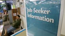 A sign instructs job seekers at the California Employment Development Department in Sunnyvale, Calif., in this file photo. (Marcio Jose Sanchez/AP)