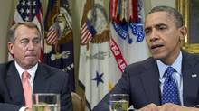 This Nov. 16, 2012 file photo shows President Barack Obama, accompanied by House Speaker John Boehner of Ohio, speaking to reporters in the Roosevelt Room of the White House in Washington. (Carolyn Kaster/AP)