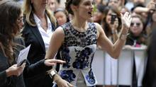 """Actress Emma Watson waves to fans at the gala presentation for the film """"The Perks of Being a Wallflower"""" at the 37th Toronto International Film Festival September 8, 2012. (MIKE CASSESE/REUTERS)"""