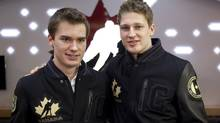 Halifax Moosehead teammates and linemates Jonathan Drouin, left, from Huberdeaux, Que., and Nathan MacKinnon, from Cole Harbour, N.S., stand together during a news conference naming the team at the National Juniors selection camp in Calgary, Alta., Thursday, Dec. 13, 2012 (The Canadian Press)