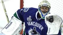 Vancouver Canucks goalie Roberto Luongo makes a save in the first period. (JOHN LEHMANN/JOHN LEHMANN/THE GLOBE AND MAIL)