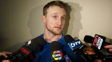 Steven Stamkos of the Tampa Bay Lightning, who is still recovering from a leg injury, is surrounded by media after skating with his team for a game-day skate at the ACC in Toronto on Jan. 28, 2014. (Peter Power/The Globe and Mail)