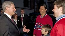 Prime Minister Stephen Harper speaks with Montreal Canadiens in Zagreb, while on an official visit to Croatia, on May 7, 2010. (Adrian Wyld/THE CANADIAN PRESS)