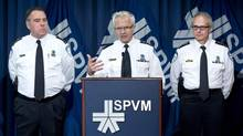 Montreal police chief Marc Parent – flanked by deputy police chief Bruno Pasquini, left, and assistant director Didier Deramond – said he was shocked by the arrest of Benoît Roberge, a former high-ranking organized crime investigator. (PAUL CHIASSON/THE CANADIAN PRESS)