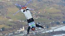 Canada's Alex Bilodeau jumps during the men's freestyle World Cup dual moguls skiing competition in Kreischberg, Austrian province of Styria, on Saturday, Dec. 22, 2012. Bilodeau placed second. (Kerstin Joensson/AP)