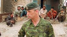 Retired colonel Pat Stogran, shown near Kandahar, Afghanistan, in 2002, was praised by Canada's top soldier for his vocal defence of veterans' rights. (Stephen Thorne/The Canadian Press)