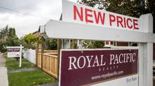 A sale sign is pictured in front of a home in Vancouver on Oct. 4, 2016. (Ben Nelms For The Globe and Mail)