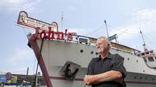 'Captain John' Letnik, top, was one of the first to draw tourists to Queen's Quay, but his days of dishing prawns on his floating restaurant are done as city agencies move to collect on unpaid taxes, rent and utilities. The restaurant, now closed, reflects to close the restaurant after the City shut his water off. (Matthew Sherwood for The Globe and Mail) (Matthew Sherwood For The Globe and Mail)