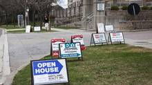 Open house signs crowd a highrise condo lawn on the Toronto lake shore last weekend. (Matthew Sherwood For The Globe and mail)