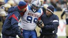 Montreal Alouettes' Scooter Berry heads off the field with an injury during the first half of their CFL game against Winnipeg Blue Bombers in Winnipeg on Saturday, November 3, 2012. Berry suffered a torn ACL and LCL on July 25, 2013, making him a scratch for the rest of the season. (John Woods/THE CANADIAN PRESS)