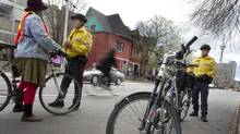 """Toronto Police Constable Blair Begbie, right, and Constable Vince Wong work a detail on Beverly Street south of Baldwin Street in Toronto on April 29, 2011. Both officers are """"bike cops"""" and were working during the one day bicycle blitz. At this location they were handing out warnings, primarily to cyclists who rode through the four-way stop at this intersection without stopping. The fine for a cyclist is the same as it would be for a motor vehicle. (Peter Power/Peter Power/ The Globe and Mail)"""
