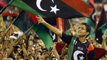 Libyan revolutionary supporters react as Libyan Transitional National Council chairman Mustafa Abdel Jalil delivers his speech on the former Green Square renamed as Martyr's Square inTripoli, Libya, Monday, Sept. 12, 2011. (Francois Mori)