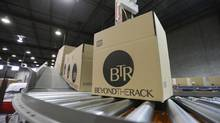 Boxes are ready to be shipped from Beyond the Rack in Montreal. (CHRISTINNE MUSCHI FOR THE GLOBE AND MAIL)