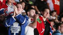 Toronto Maple Leafs fans cheers during third period NHL action against the Montreal Canadiens in Montreal, October 1, 2013. (Christinne Muschi/Christinne Muschi/The Globe and)