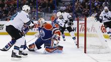 San Jose Sharks forward Joe Pavelski (8) scores on Edmonton Oilers goaltender Ben Scrivens (30) during the during the second period at Rexall Place. (Perry Nelson/USA Today Sports)