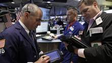 Traders work with specialist Christopher Culhane, center, on the floor of the New York Stock Exchange Friday, June 15, 2012. (Richard Drew/AP)