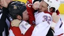 Ottawa Senators' Chris Neil (25) fights with Travis Moen (32) during the third period of game three of the first round of Stanley Cup hockey action on May 5, 2013 in Ottawa. Ottawa beat Montreal 6-1. (Fred Chartrand/The Canadian Press)