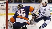 Toronto Maple Leafs Clarke MacArthur (16) puts a shot on goal against the New York Islanders goalie Al Montoya during the first period of their NHL hockey game in Uniondale, New York, March 8, 2011. (SHANNON STAPLETON)