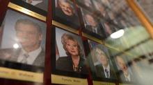 A photograph of Senator Pamela Wallin is displayed alongside photographs of her fellow Senators in the Centre Block of Parliament Hill in Ottawa on Tuesday, August 13, 2013. (Sean Kilpatrick/THE CANADIAN PRESS)