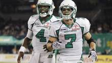 Saskatchewan Roughriders quarterback Darian Durant celebrates after throwing a touchdown to Weston Dressler (R) against the Toronto Argonauts during the second half of their CFL in Toronto, October 8, 2012. (MARK BLINCH/REUTERS)