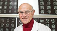 Dr. Charles Tator is seen with MRI brain scans at Toronto Western Hospital on Feb. 6, 2011. (Jennifer Roberts for The Globe and Mail/Jennifer Roberts for The Globe and Mail)