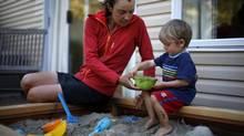 Kate Soles with her son Eliot, nearly two years old, as he plays in the sandbox at home in Victoria. (CHAD HIPOLITO FOR THE GLOBE AND MAIL)