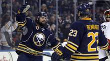 Buffalo Sabres defenseman Zach Bogosian celebrates his goal during the second period with Buffalo Sabres center Sam Reinhart against the Ottawa Senators at First Niagara Center. (Timothy T. Ludwig/USA Today Sports)