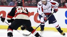 Washington captain Alex Ovechkin attempts to move the puck past Erik Karlsson on Tuesday. (BLAIR GABLE/REUTERS)