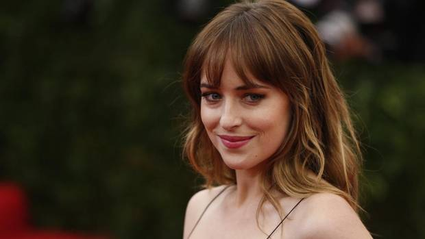 "Fifty Shades of Grey- Actress Dakota Johnson arrives at the Metropolitan Museum of Art Costume Institute Gala Benefit celebrating the opening of ""Charles James: Beyond Fashion"" in Upper Manhattan, New York, May 5, 2014. The first trailer for the movie version of E.L. James's novel depicts Jamie Dornan and Dakota Johnson coyly getting to know each other – then come the handcuffs. (youtube.com) (© Lucas Jackson / Reuters/REUTERS)"