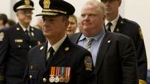 Fire Chief Jim Sales, front, and Toronto Mayor Rob Ford walk into the graduation ceremony for 40 Toronto Fire Services recruits at the Toronto Fire Academy in Toronto on Feb. 01, 2013. (Peter Power/The Globe and Mail)