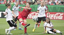 Canada's Lindsay Agnew is surrounded by German players during the FIFA U-20 Women's World Cup quarter-finals in Edmonton on Aug. 16, 2014. (Jason Franson/The Canadian Press)