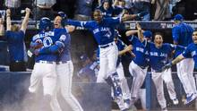 Toronto Blue Jays' Josh Donaldson, left, celebrates with Troy Tulowitzki, second left, after he was safe at home as his team comes off the bench to celebrate their walk off win in the tenth inning to eliminate the Texas Rangers in American League Division Series action in Toronto on Sunday, October 9, 2016. (Mark Blinch/The Canadian Press)