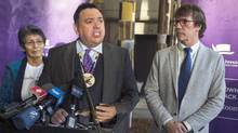 Morley Googoo, Assembly of First Nations regional chief, Mike Downie, right, and Pearl Wenjack, left, announce the Gord Downie and Chanie Wenjack Fund legacy project on Nov. 29, 2016. (Andrew Vaughan/THE CANADIAN PRESS)