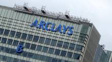 "The letter ""B"" of the signage on the Barclays headquarters is hoisted up the side of the building in London July 20, 2012. (SIMON NEWMAN/Reuters)"