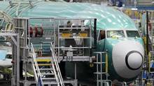 A Boeing Co. 737 airplane is lined up at the company's assembly facility in Renton, Wash. (TED S. WARREN/AP)